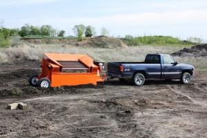 The EZ-550 Topsoil screener toed by pickup truck